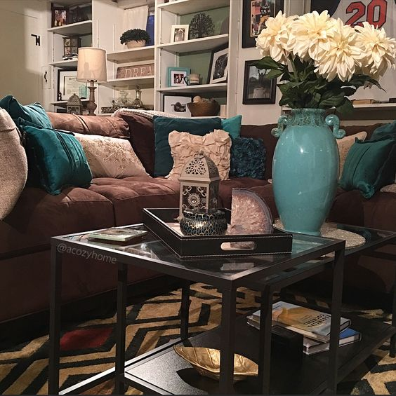 Cozy brown couch with teal accents, turquoise and brown, built-in shelves, ikea nesting table #acozyhome