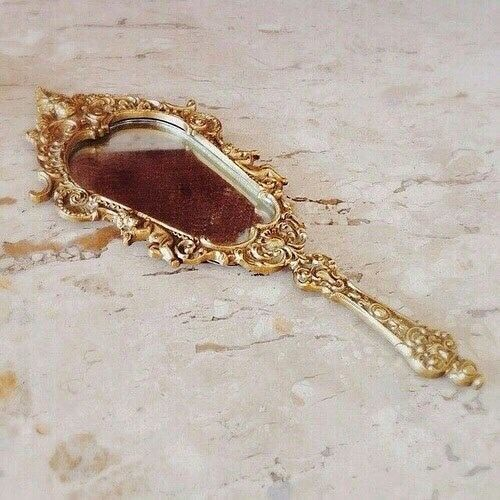 Beauty is eternity gazing at itself in a mirror. - Khalil Gibran 💛🖤 #beauty #gold #mirror