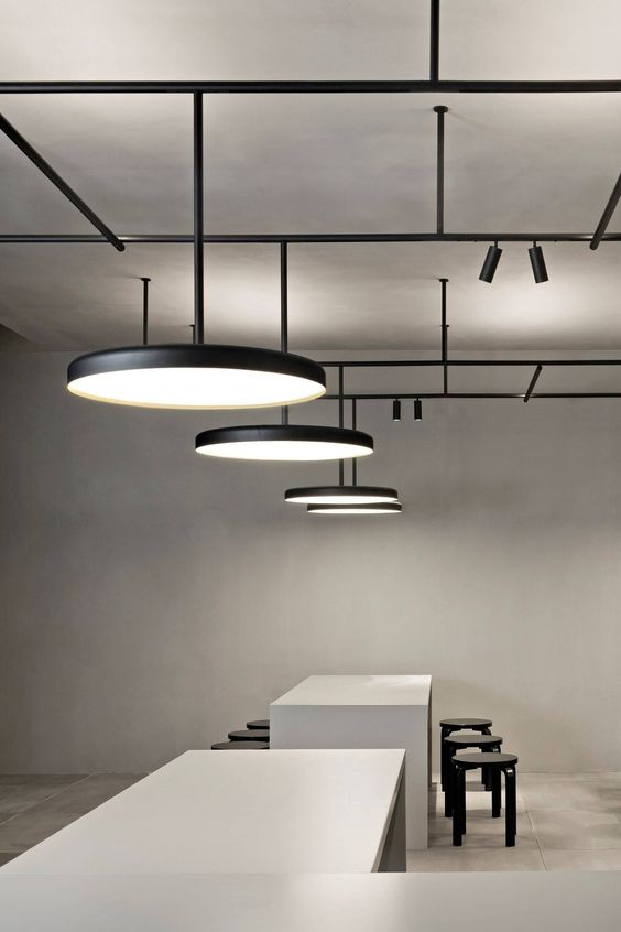 Vincent Van Duysen's Infrastructure lighting system for Flos Architectural on display. Stand x VVD | Minimalissimo