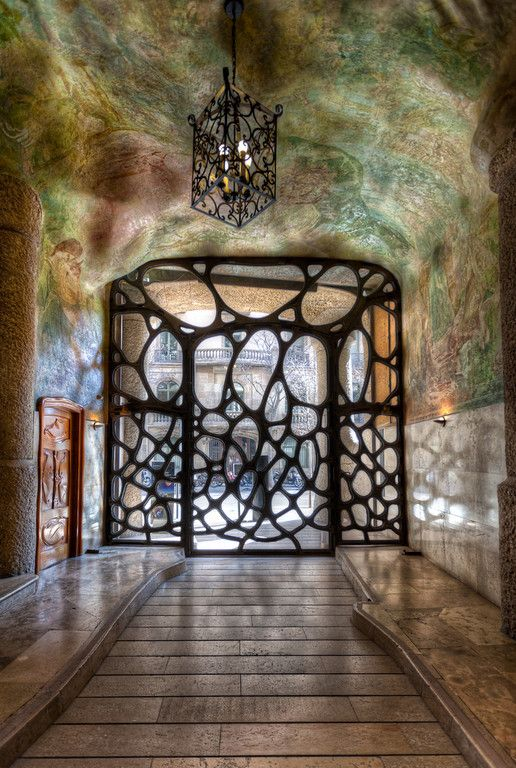 Iron gate & stone carving --- Barcelona apartment building --- La Pedrera, by Antoni Gaudí. He was not just a creative architect.                                                                                                                                                      Más
