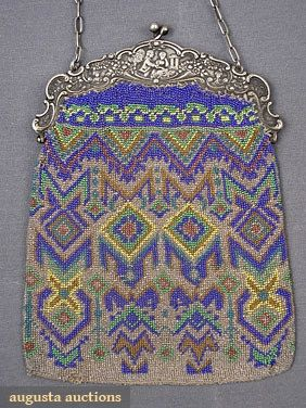 GEOMETRIC BEADED BAG, c. 1910   Silver ground w/ blue, yellow & green glass beads, silver tone frame decorated w/ lovers in landscape, (small holes, missing fringe) good; t/w 1 metallic beaded bag w/ house & flowers.