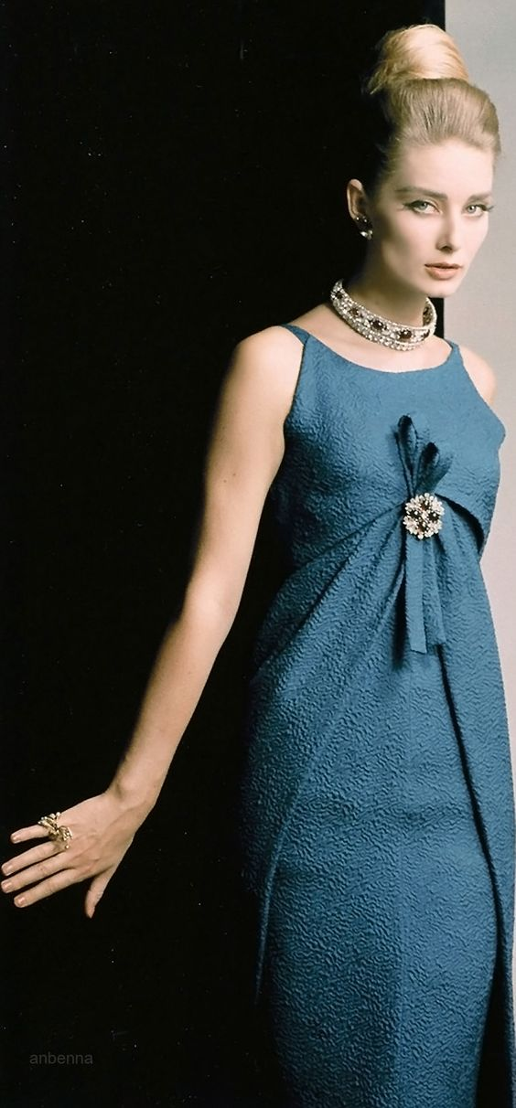 Tania Mallet in brilliant blue Empire line gown by Dior, jewelry of brilliants and quartz also by Dior, photo by Vernier, Vogue UK, September 1962