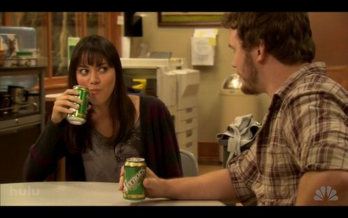 April and Andy drinking Vernors ginger ale on Parks & Recreation. The show is set in IN, the pop is from MI :)