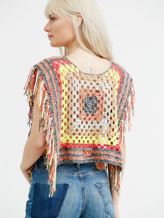 Electric Avenue Crochet Pullover | Handmade in Italy, this groovy crochet knit pullover features metallic knit detailing and fun fringe hem. Rounded neckline and cropped poncho silhouette.