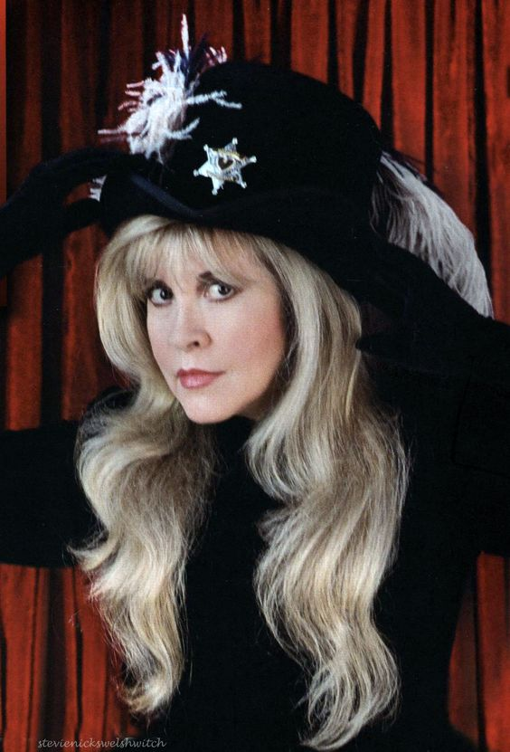 Stevie ~ ☆♥❤♥☆ ~ wearing a fabulous plumed cowboy hat that has a badge on it, given to her by Tom Petty; he made her an honorary member of his band, Tom Petty and The Heartbreakers ~ https://en.wikipedia.org/wiki/Tom_Petty_and_the_Heartbreakers