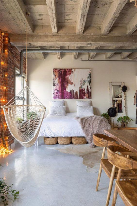 industrial bedroom with exposed concrete ceiling beams #industrialbathroom