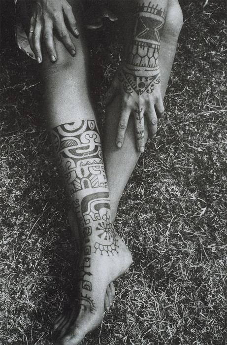 I like the idea of incorporating a small tribal inspired element.   I love the placement on her right leg as well.