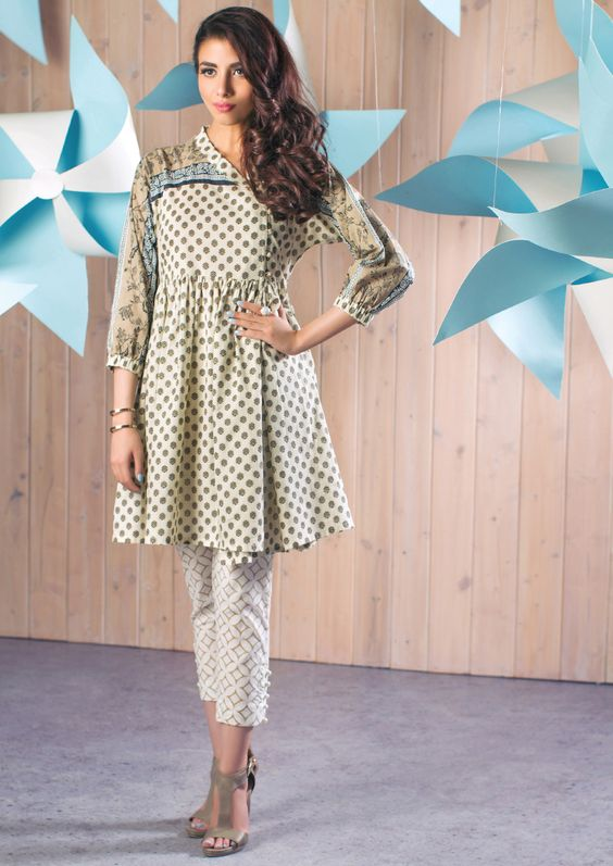 Stitching Styles Of Pakistani Dresses White Dotted print Style
