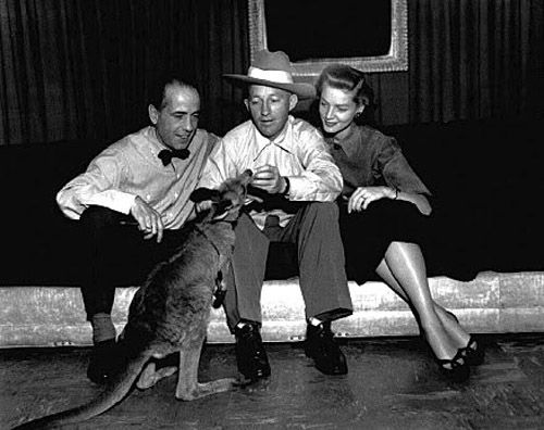 Humphrey Bogart, Bing Crosby, and Lauren Bacall with a kangaroo (wallaby?), c, 1950s