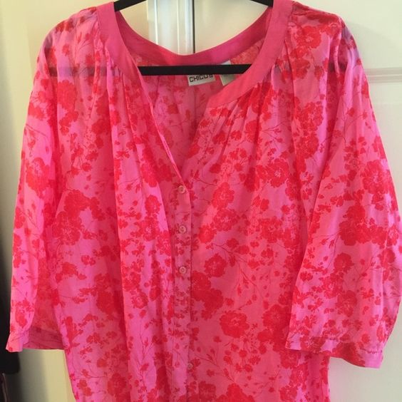 Very cute top OK ladies I am literally cleaning out my storage unit that has so many of my clothes that I no longer can wear.  The clothes are all clean some of them are new and have never been worn.  They are wrinkled because they have been in boxes.  Happy shopping!! Chico's Tops Blouses