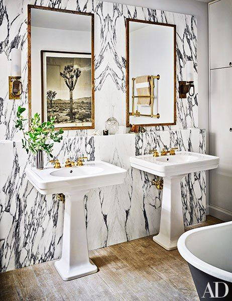 Masterbath inspiration re: transitional feel, love the marble, mirrors and tub Another work by Fernando Bengoechea is reflected in one of the master bath's custom-made mirrors from Robert Massello Antiques; the sconces are midcentury French, the sinks and fittings are by Waterworks, and the floor tile is by Ann Sacks.