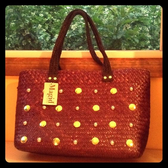 Woven plum studded handbag Plum with studs...woven straw material :) brand new with tags never used...will also consider trading for another handbag! Let me know magid Accessories