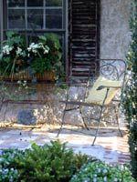 Porch - stone - window box - chair - pillow