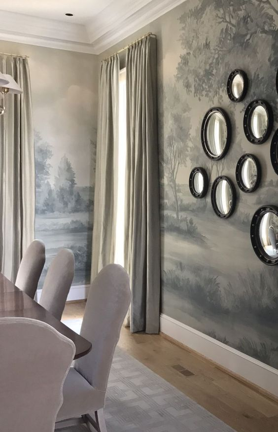 Stunning traditional style dining room with mural wallpaper and a collection of round mirrors massed on wall. #susanharter #mural #wallpaper