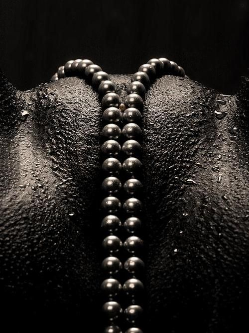 Black pearls on black skin...