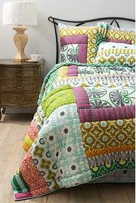 I'm normally an 'all white' bedlinen kind of girl... but i do love this.   Lille Quilt