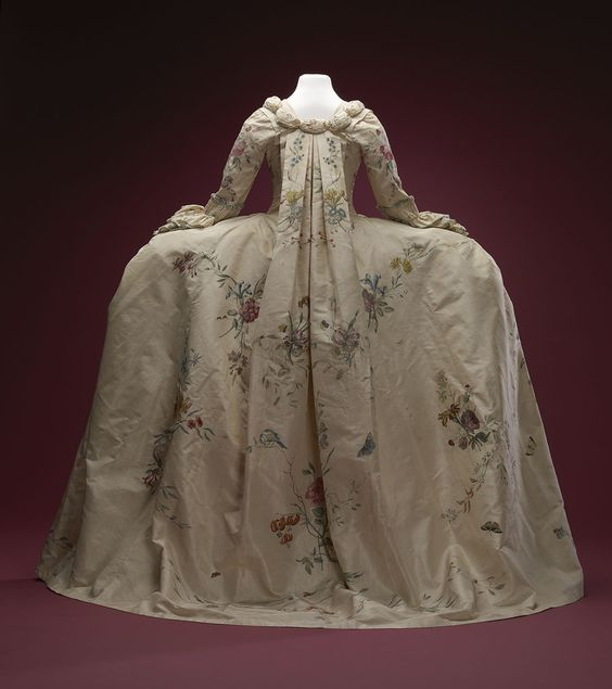 Rear view, robe à la francaise, 1740-1760. Cream silk, beautifully hand-painted with floral motifs, flower sprays, birds and insects; self-fabric trimming, linen lining.