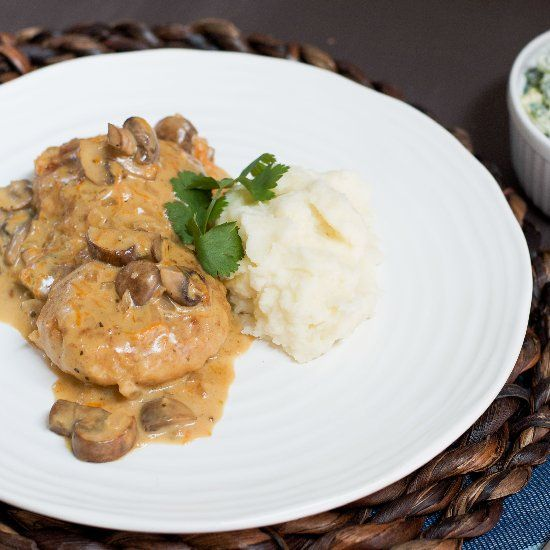 Breaded chicken patties fried and simmered in creamy mushroom sauce.