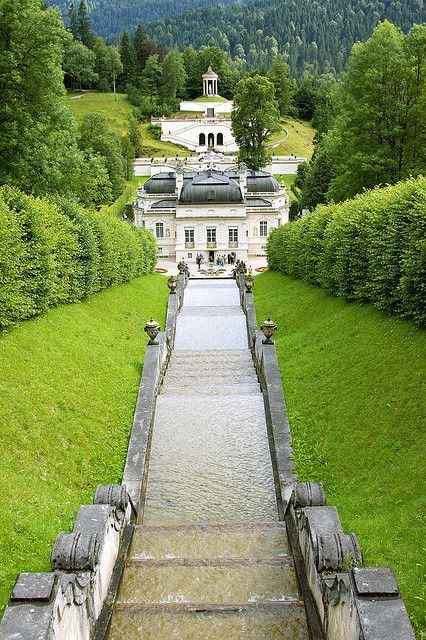 Schloss Linderhof, Bavaria, Germany....I was here in 2005, Beautiful Property....this view is at the top of the waterfall in the back yard...the cool breeze over the waterfall, was used as the king's Air Conditioning while he opened his window!! Neat huh!!