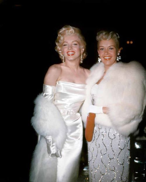 perfectlymarilynmonroe:  Marilyn and Betty Grable photographed in 1953.