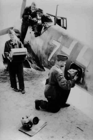 Loading up the cameras. Dinard in France 1941