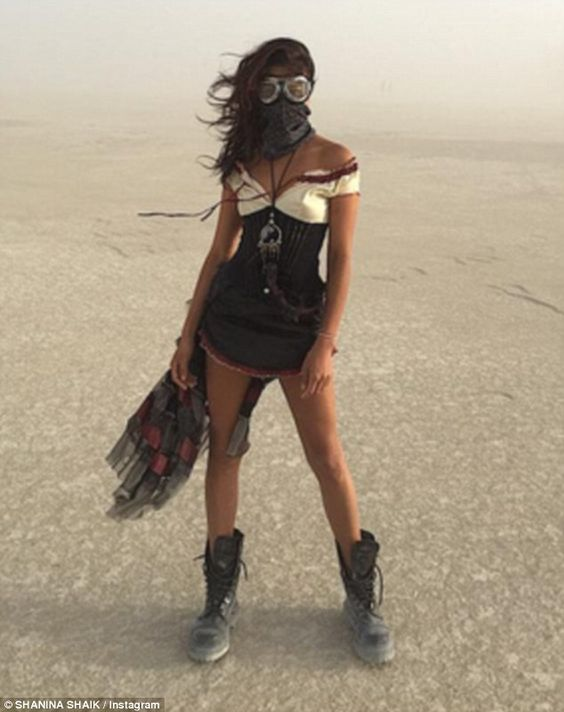 Working it: Shanina proved that she can look picture perfect even in the midst of a sandstorm as she showcased her toned legs whilst protecting her face with goggles and a scarf