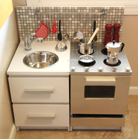 We've seen and featured plenty of sweet and feminine DIY play kitchens.  If you're looking for inspiration for something more masculine, check out this modern play kitchen Carla made.