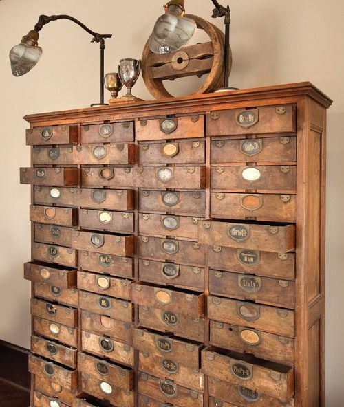 "bookspaperscissors:    repurposed furniture: an old patent file, ""In the drawers are little logs of people who filed patents and the dates and their descriptions."""