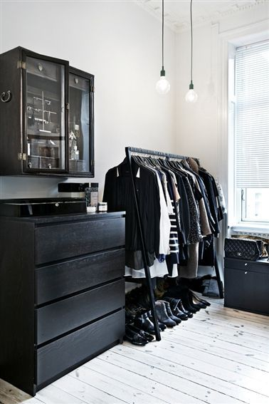 Black furniture white room: