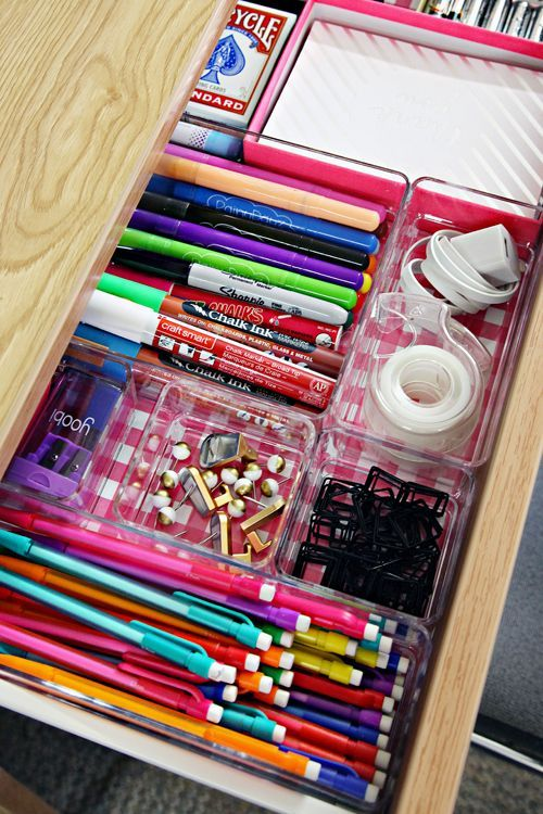 Line your desk drawers with scrapbook paper and add clear plastic organizers to keep things neat and organized.: