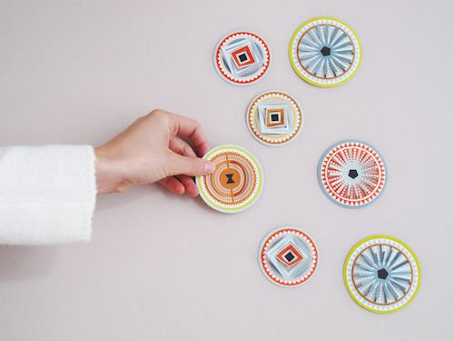 these paper circles ornaments by jurianne matter are very versatile!   http://zonnelijk.co.uk/circles