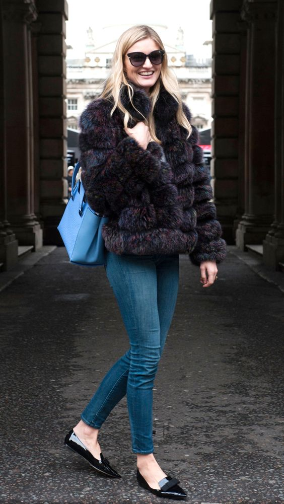 How to mix luxury and comfort —pair your favorite jeans with a faux fur coat. | London Fashion Week via IMAXTREE