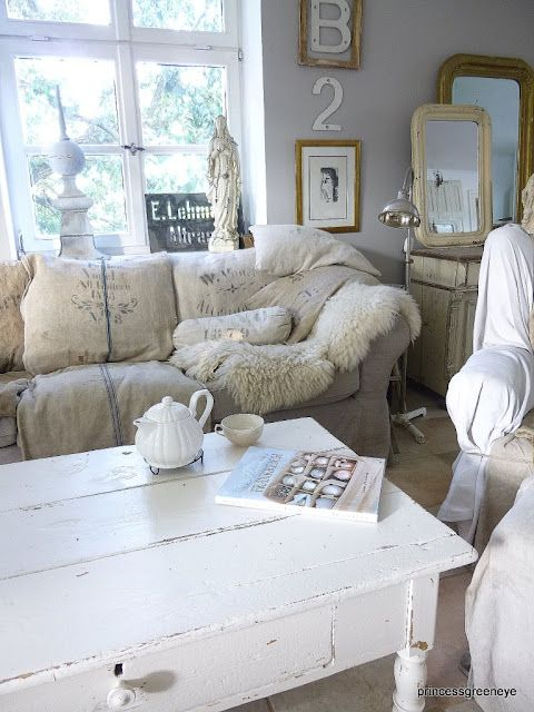 love the rustic white colour scheme....what a place to just curl up and read an old book!