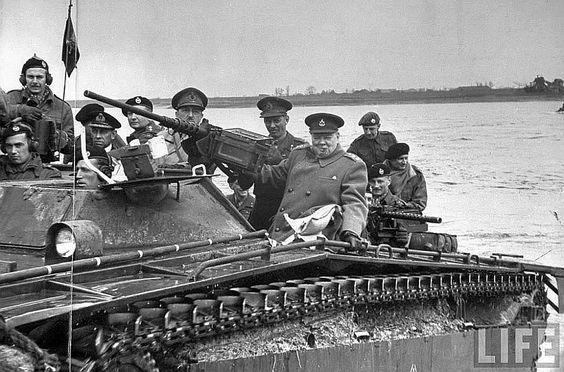 """m4a1-shermayne: """" Churchill and other members of the brass including Bernard Montgomery cross the Rhine on a LVT, 1945. """""""