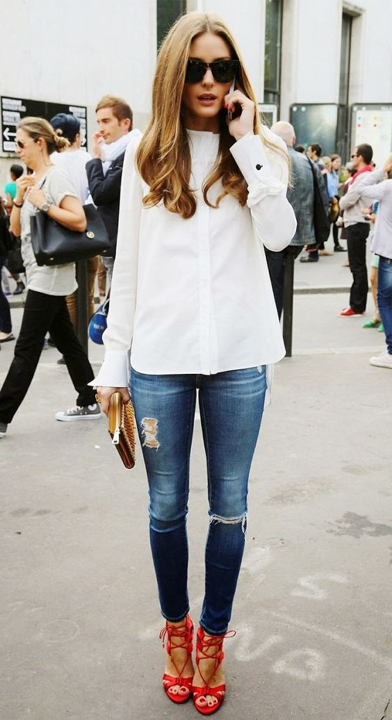 Olivia Palermo and white shirt + ripped and frayed skinny jeans and red strappy heels: