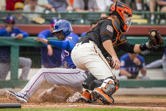 Texas Rangers infielder Pedro Ciraco scores past San Francisco Giants catcher Buster Posey on a single by infielder Jurickson Profar during the third inning of a spring training game at Scottsdale Stadium on Saturday, March 5, 2016, in Scottdale, Ariz. (Smiley N. Pool/The Dallas Morning News)