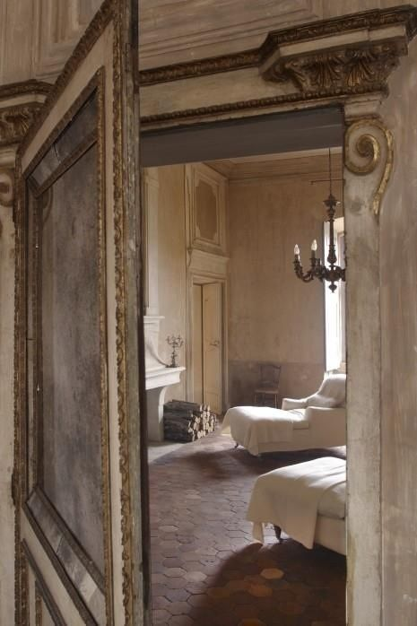 Magnificent paneled Old World door to a beautiful room in a French chateau. Weathered Walls & Déshabillé Lovely. #chateau #door #walls #distressed #weathered #oldworld #French