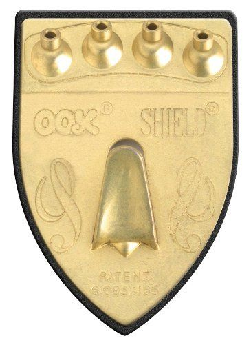 OOK 55007 Shield Picture Hanger Supports Up to 100 Pounds, Brass by OOK. Save 25 Off!. $6.41. From the Manufacturer                OOK Shield offers the ultimate protection for your walls. The patented shock absorbing layer protects the walls from indentations which can be made by picture hangers and allows you to move the hanger around the wall without leaving a mark. Leaves you hands free, making hammering easier.                                    Product Description      ...