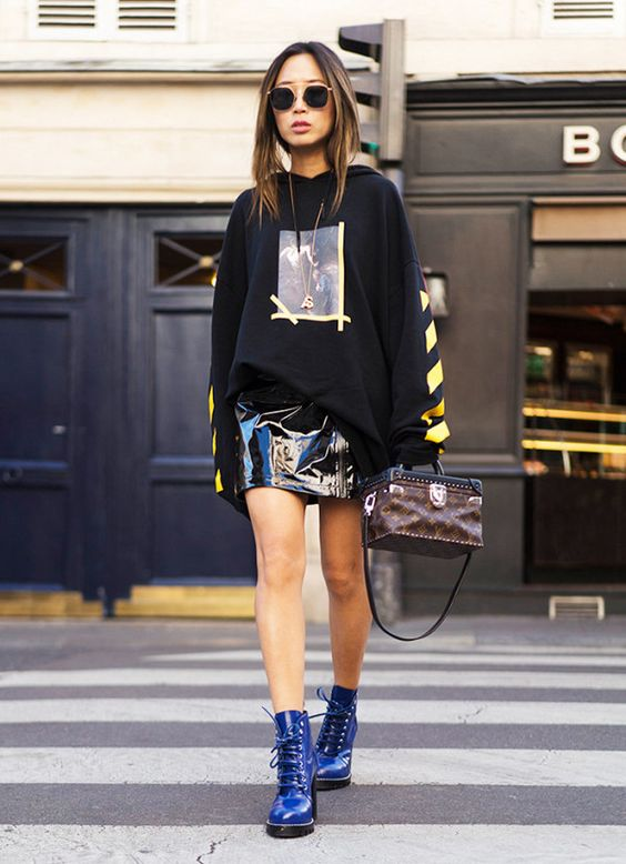 Patent leather miniskirt + graphic sweatshirt + combat boots