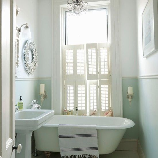 Shutters and claw foot tub