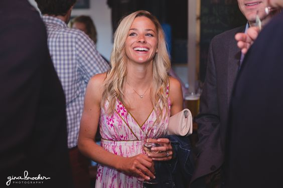 A candid photograph of a lady laughing during a rehearsal dinner in Nantucket Gina Brocker Photography