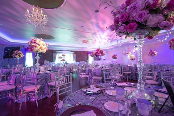 textured pink lighting and statement centerpieces | event center at blue