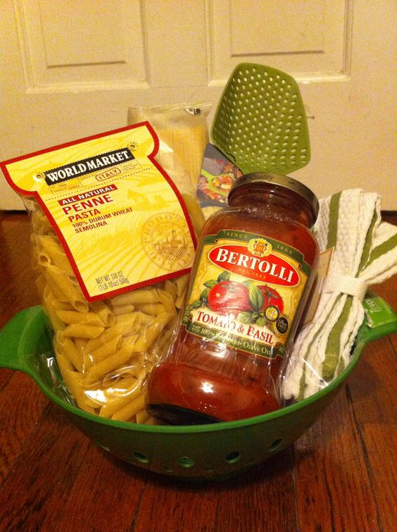 Housewarming gift- pasta, sauce, dish towels, and a pasta spoon in a colander
