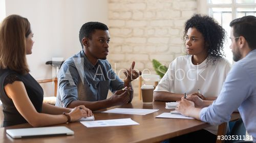 African American Young Manager Explaining Research Results To Concentrated Teammates Sponsored Young Manager Africa In 2020 African American American African