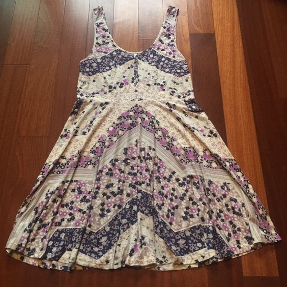 Free People Floral Printed Dress A Free People white and purple floral printed dress. Material is a polyester blend. Free People Dresses Midi