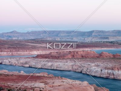 mountain range and river with clear sky in background at lake mead - High angle view of mountain range and river with clear sky in background.