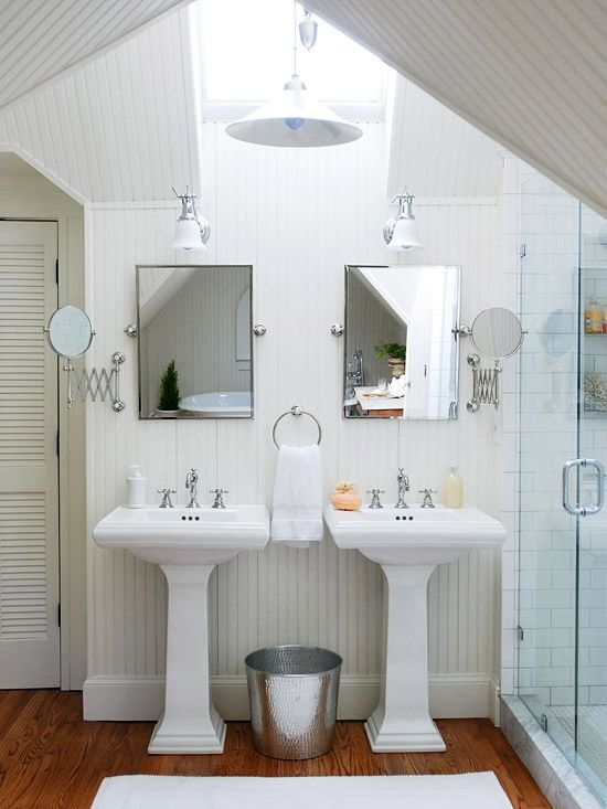 Classic white bath.  Skylight + pair of pedestal sinks + wainscoting