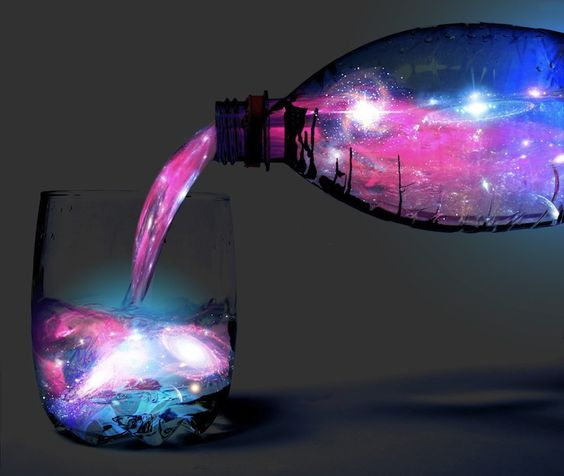 crazy! it's a glow-in-the-dark aurora borealis cocktail you can actually make!