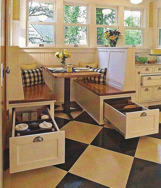 Kitchen nook with hidden storage- love this!