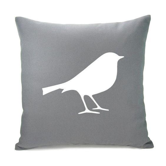 grey pillow with bird applique